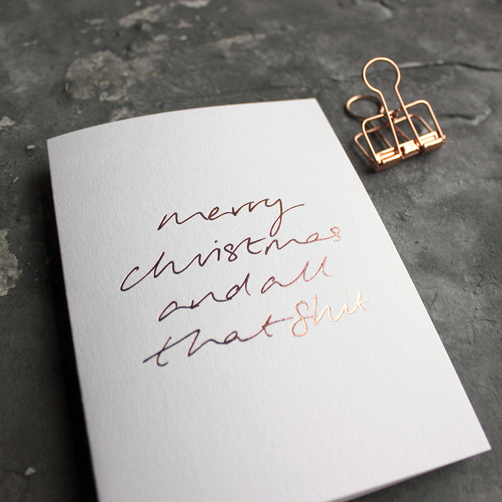 This luxury white card has a hand foiled rose gold message on the front that says Merry Christmas and all that Shit