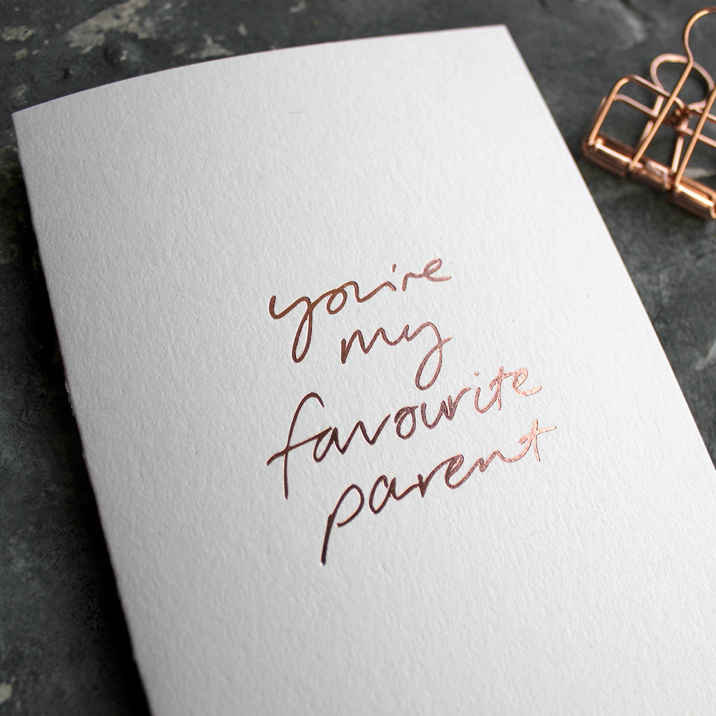 The front of the card says You're My Favourite Parent handwritten and stamped in rose gold foil