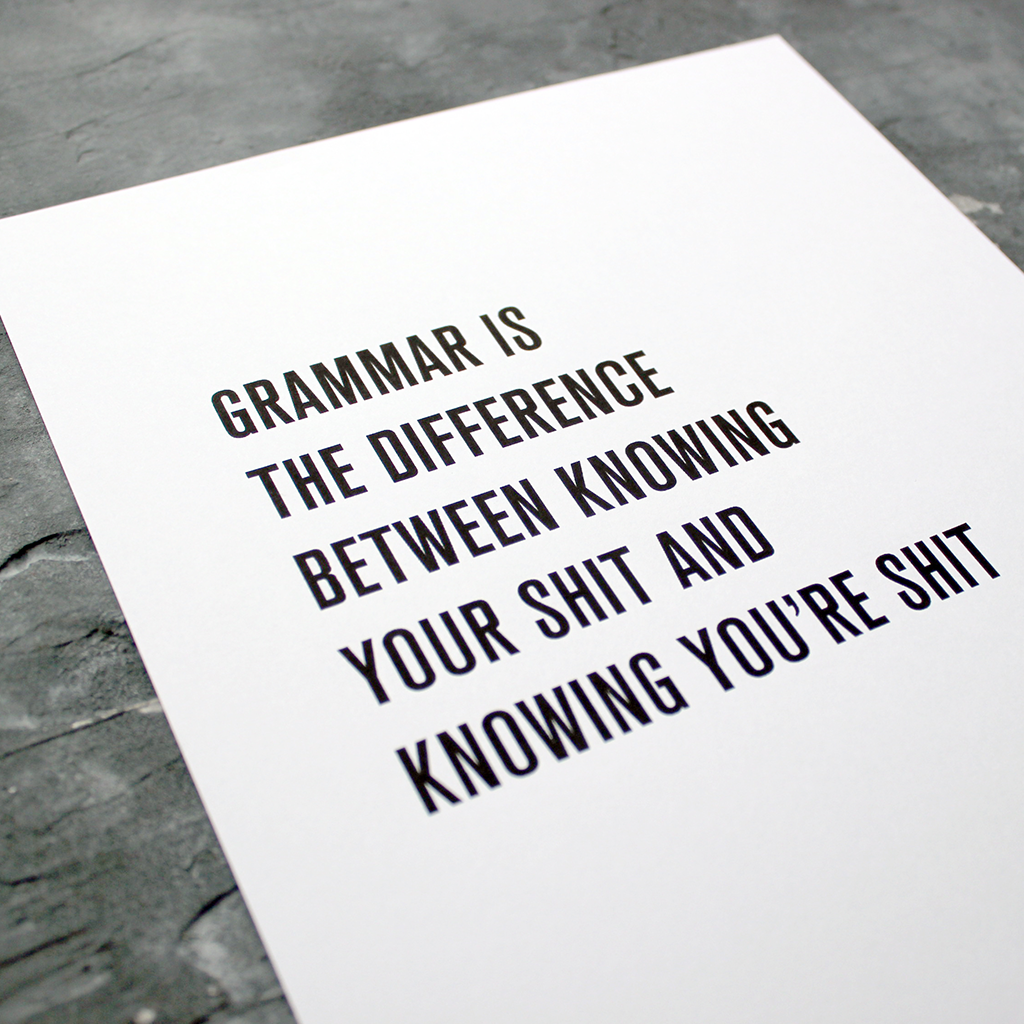 A digital print that states 'Grammar is the difference between knowing your shit and knowing you're shit' in a white frame
