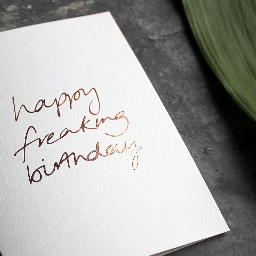 this birthday card has a handwritten rose gold foil message saying happy freaking birthday