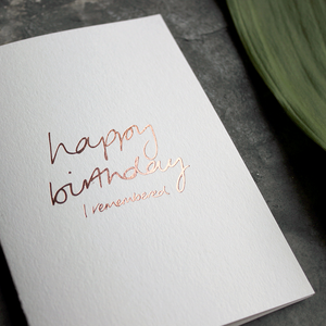 the card has happy birthday I remembered hand written in rose gold foil on the front