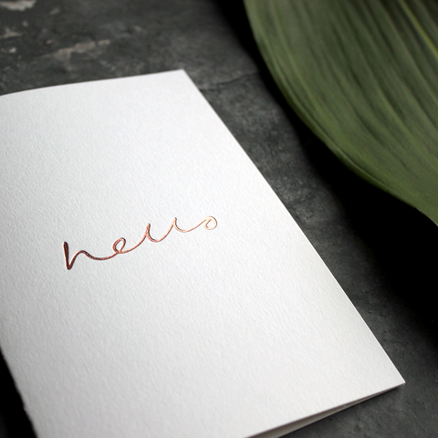 an all round card to send for any occasion that has hello hand written and foil stamped in rose gold