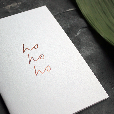 luxury handmade rose gold foil card says ho ho ho on the front