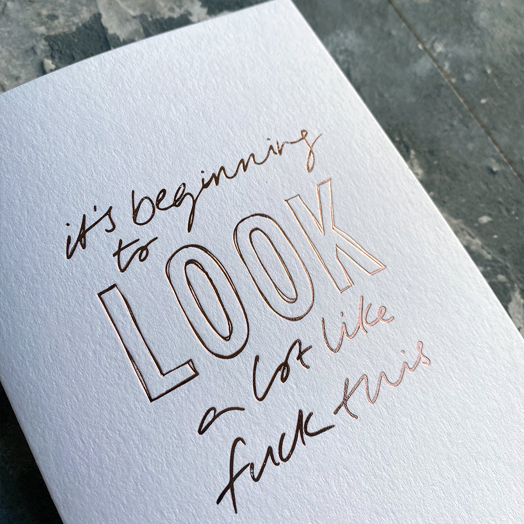 This luxury Christmas Card has a hand written rose gold foil block message saying It's Beginning To Look A Lot Like Fuck This on the front