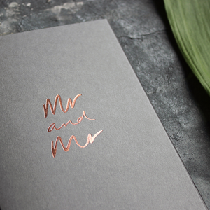 This luxury grey wedding card for the gay couple says Mr and Mr on the front, handwritten and hand foiled in rose gold