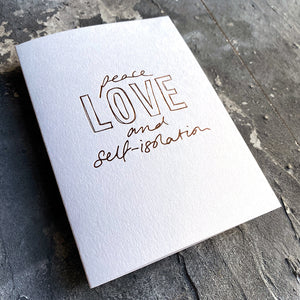 This luxury Christmas Card has a hand written rose gold foil block message saying Peace Love and Self-Isolation on the front