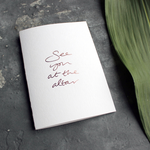 a luxury white wedding card that's handwritten with a rose gold foil message saying See You At The Altar
