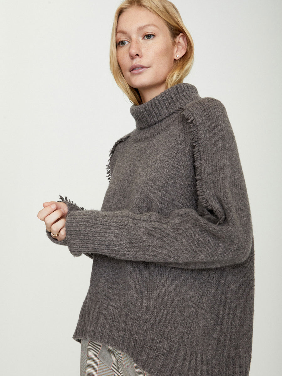The Odene Fringe Turtleneck