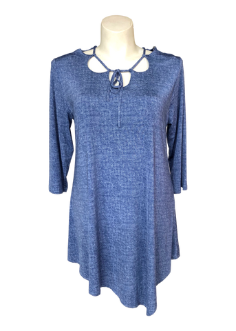 Plus size trapeze top with laced neckline in denim blue.