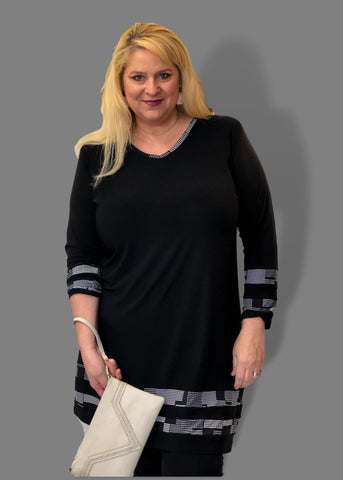 v-neck tunic dress in black with textured print stripes around bottom and at wrists for plus size