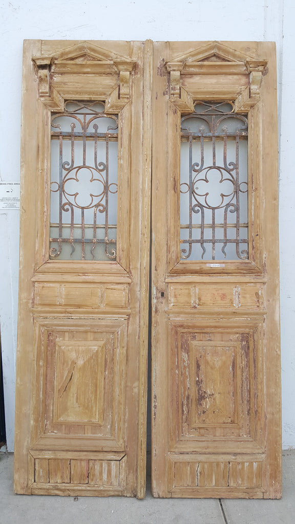 Pair of Carved Wood Doors with Iron Inserts