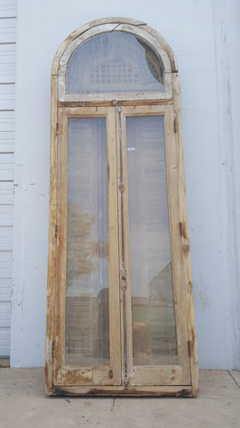 Pair of French Doors and Shutters with Ornate Spindled Transom