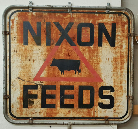 "Sign, ""Nixon Feeds"" with a hog in the middle (Restaurant)"