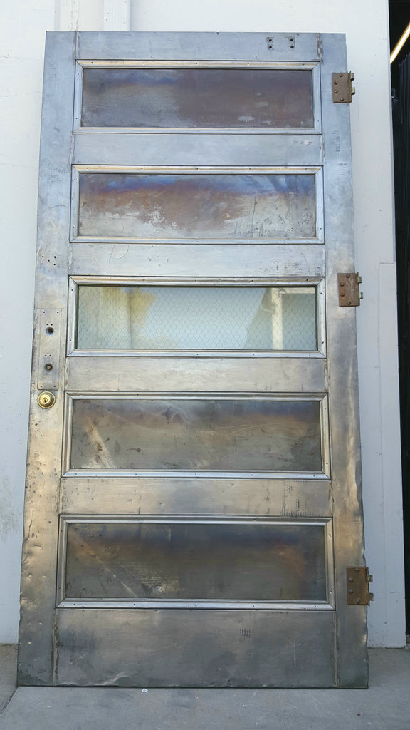 Large Steel Fire Door With 4 Solid Panels And 1 Chicken Wire Glass
