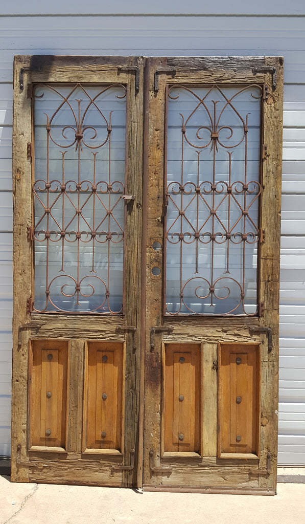 Pair Of Wood And Iron Doors With Glass Antiquities Warehouse