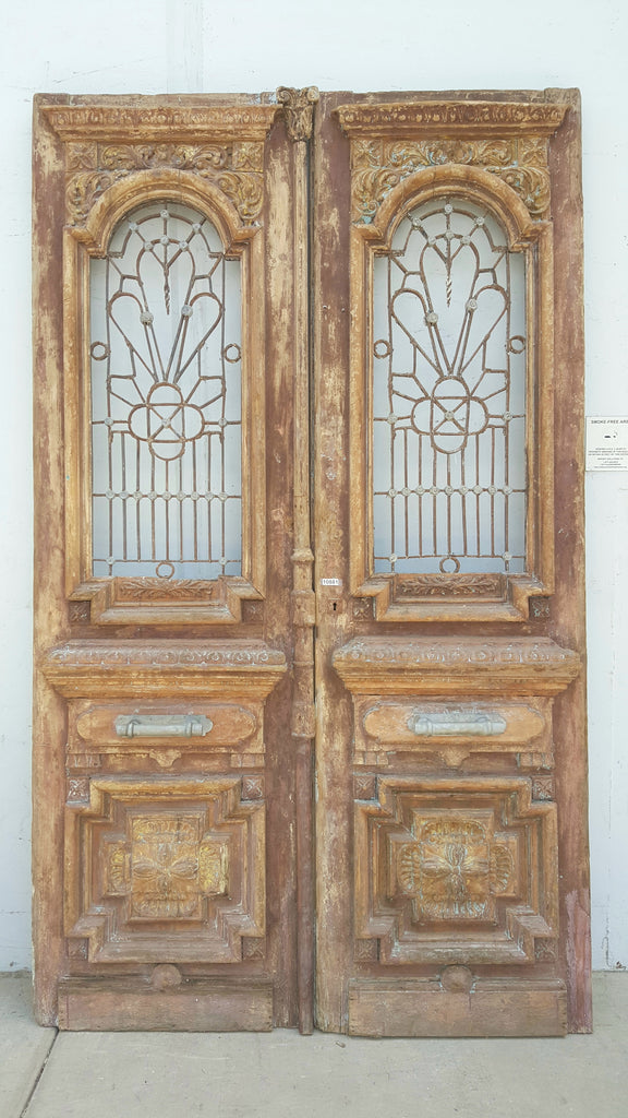 Pair of Wood Carved Door with Iron Inserts