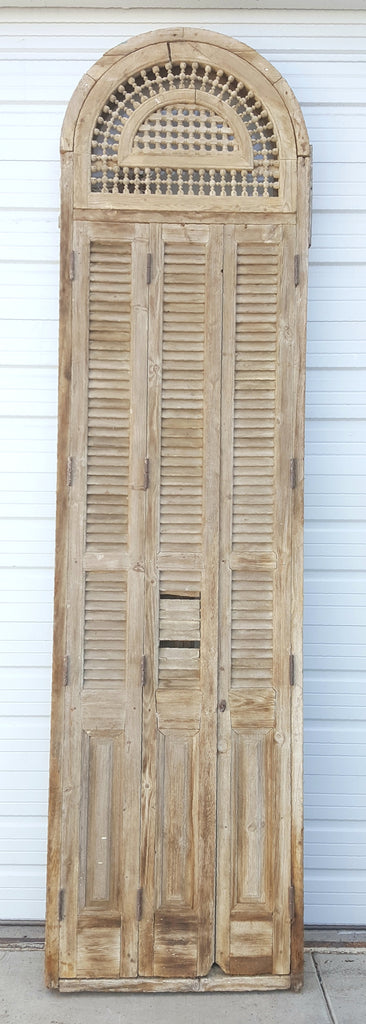 Tall Window with Shutters and Decorative Spindles