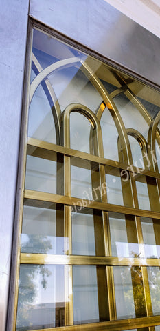 Stainless Steel Entry Door With Brass Gothic Insert from Madison Avenue