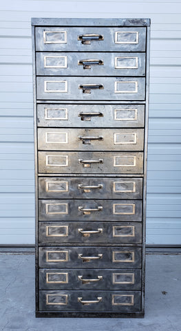 Stripped Metal File Cabinet
