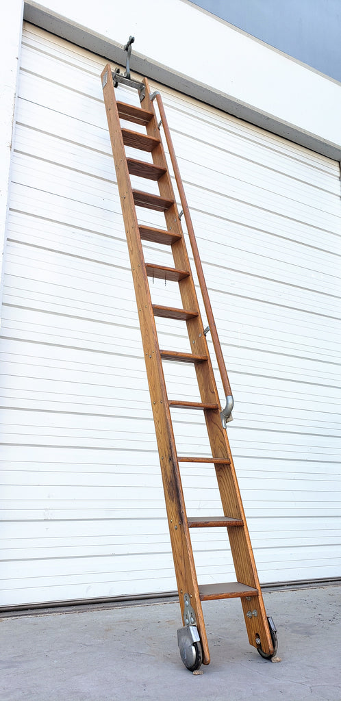 Library ladder with handle on side