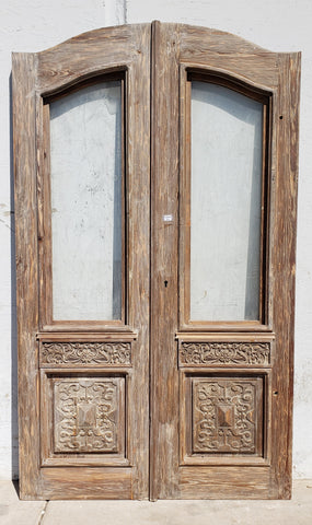Pair of Wood French Doors with One Lite and Carved Panels