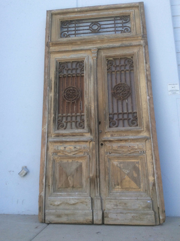 Large, Old Doors with Transom and Iron Inserts