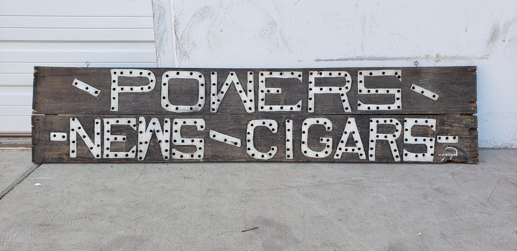 Powers News / Cigars Sign
