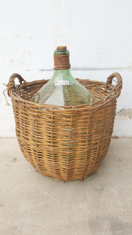 Clear Glass Demijohn Wine Bottle in Wicker Basket