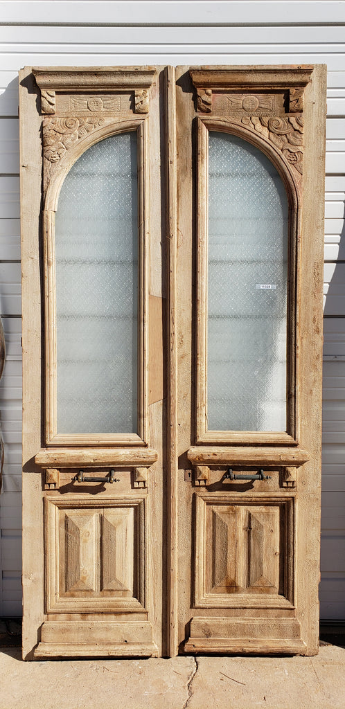 Pair of Wood Doors with Arched Single Glass Panes