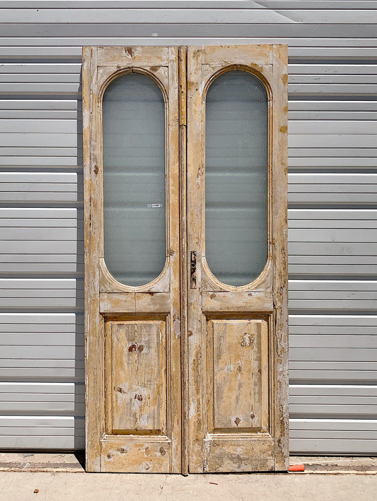 Pair of Oval Lite Washed Wood Panel Doors