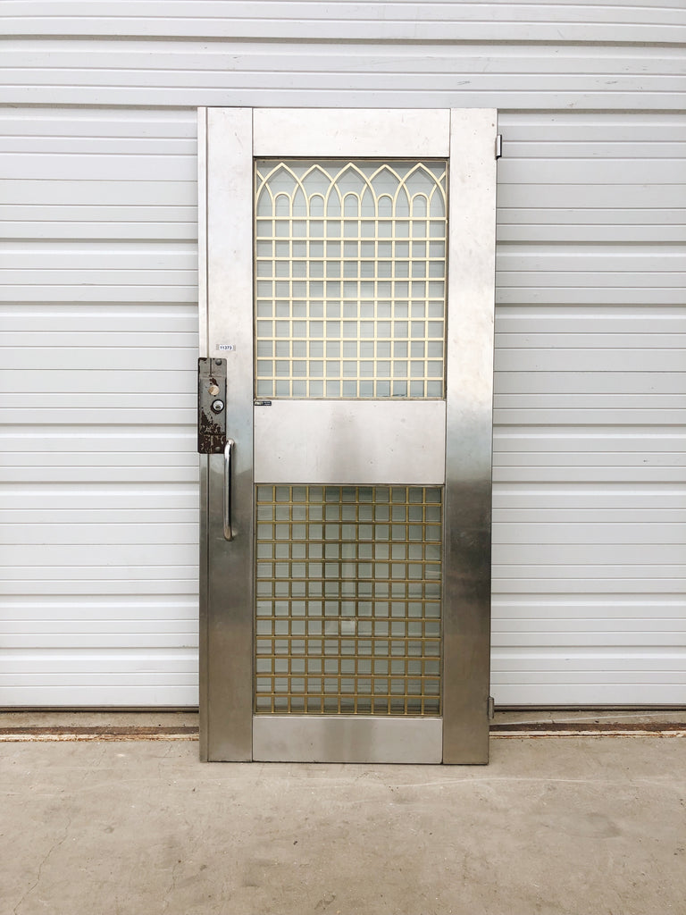 Stainless Steel Entry Door With Brass Gothic Insert