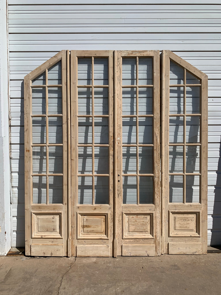 Set of Antique Bi-Folding 40 Lite Arched Natural Wood French Doors