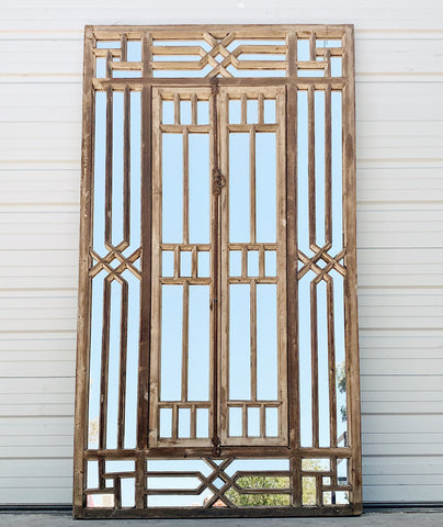 Repurposed Paneled Mirrored Window