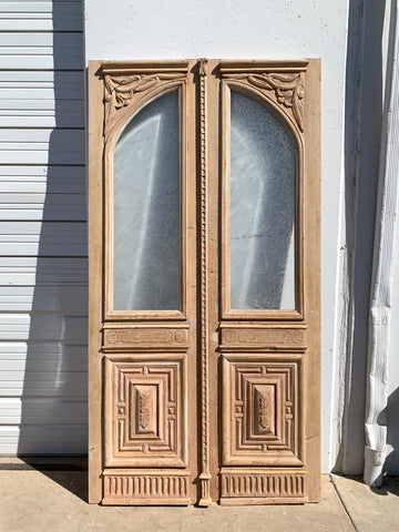 Pair of Antique Arched Lite Carved Natural Wood French Doors