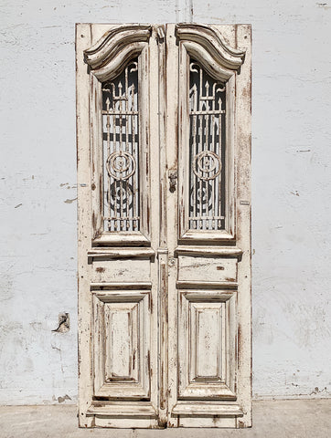 Pair of Ornate Carved Wood 2 Panel Doors with Iron Inserts