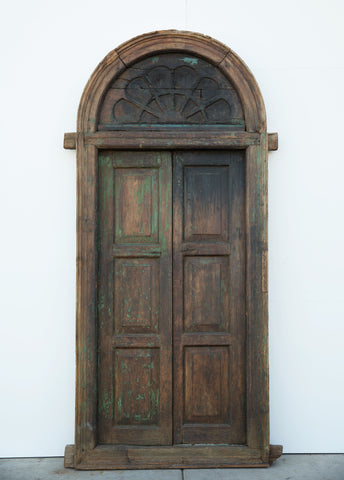 Pair of 3 Panel Wood Doors With Carved Half-Round Transom
