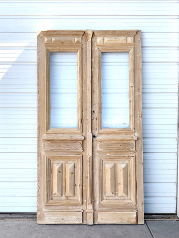 Pair of Antique Carved Panel Natural Wood French Doors