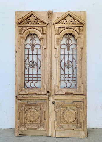 Pair of Ornate Carved Wood Doors with Iron Inserts