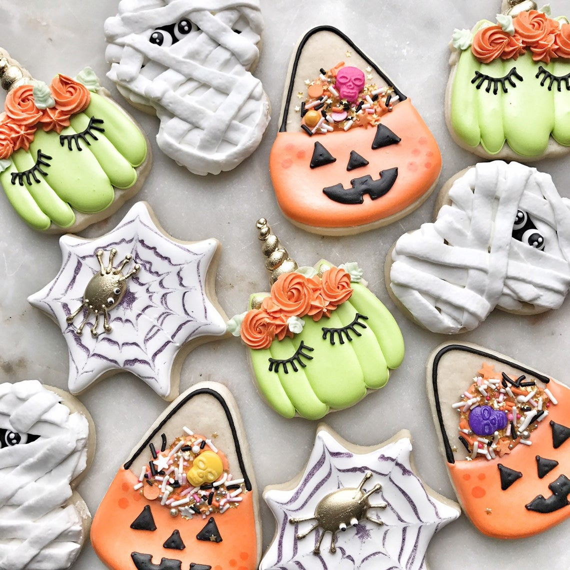 Trick Or Treat Bucket, Spider Web, Pumpkin Unicorn, Mummy Halloween Iced Sugar Cookies by Royally Iced Sweets on TheIcedSugarCookie.com
