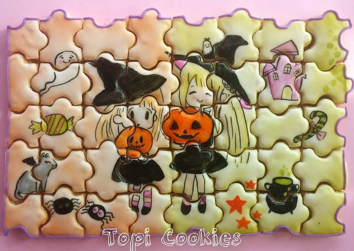 Halloween Cookie Puzzle created by @TopiCookies was featured on TheIcedSugarCookie.com #halloweencookies #halloweensugarcookies #halloween #cookies #sugarcookies #decoratedsugarcookies