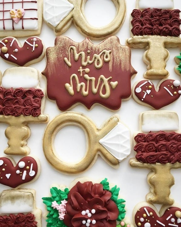"Miss To Mrs ""Bride To Be"" Wedding Iced Sugar Cookies by @flourfox featured on TheIcedSugarCookie.com #sugarcookies #decoratedcookies #icedsugarcookies #theicedsugarcookies #weddingcookies #bridecookies #weddingsugarcookies #bridesugarcookies"