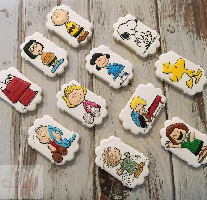 Snoopy Charlie Brown Peanuts Iced Sugar Cookies by @thenewyorkcookieboutique on TheIcedSugarCookie.com #snoopycookies #charliebrowncookies #sugarcookies #cookies #theicedsugarcookie