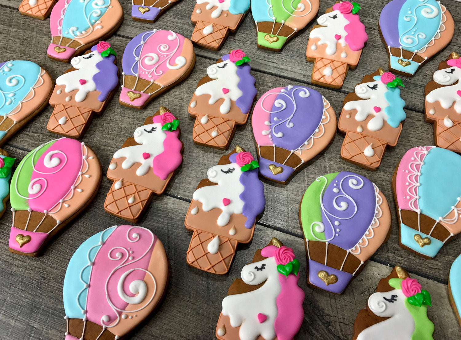 Unicorns And Hot Air Balloons Iced Sugar Cookies created by Tale Cookies featured on TheIcedSugarCookie.com #cookies #sugarcookies #decoratedcookies #unicorncookies #hotairballooncookies #theicedsugarcookie