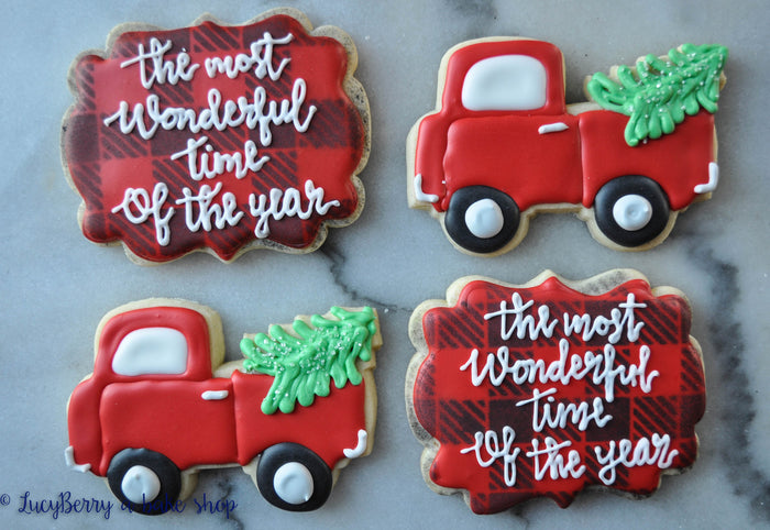 "Holiday Truck Hauling Christmas Trees Decorated Iced Sugar Cookies featured on TheIcedSugarCookie.com Created by ""LucyBerry A Bake Shop"" #sugarcookies #christmascookies #decoratedchristmascookies #cookies #christmas #icedsugarcookies #theicedsugarcookie"