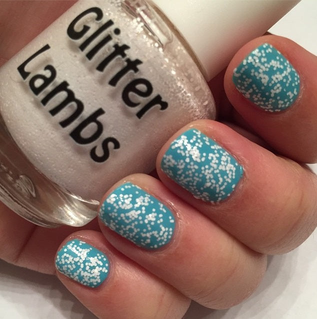 "Glitter Lambs ""Snowball"" glitter topper nail polish. www.TheIcedSugarCookie.com Winter White Glitter Nails. Custom handmade nail polishes."