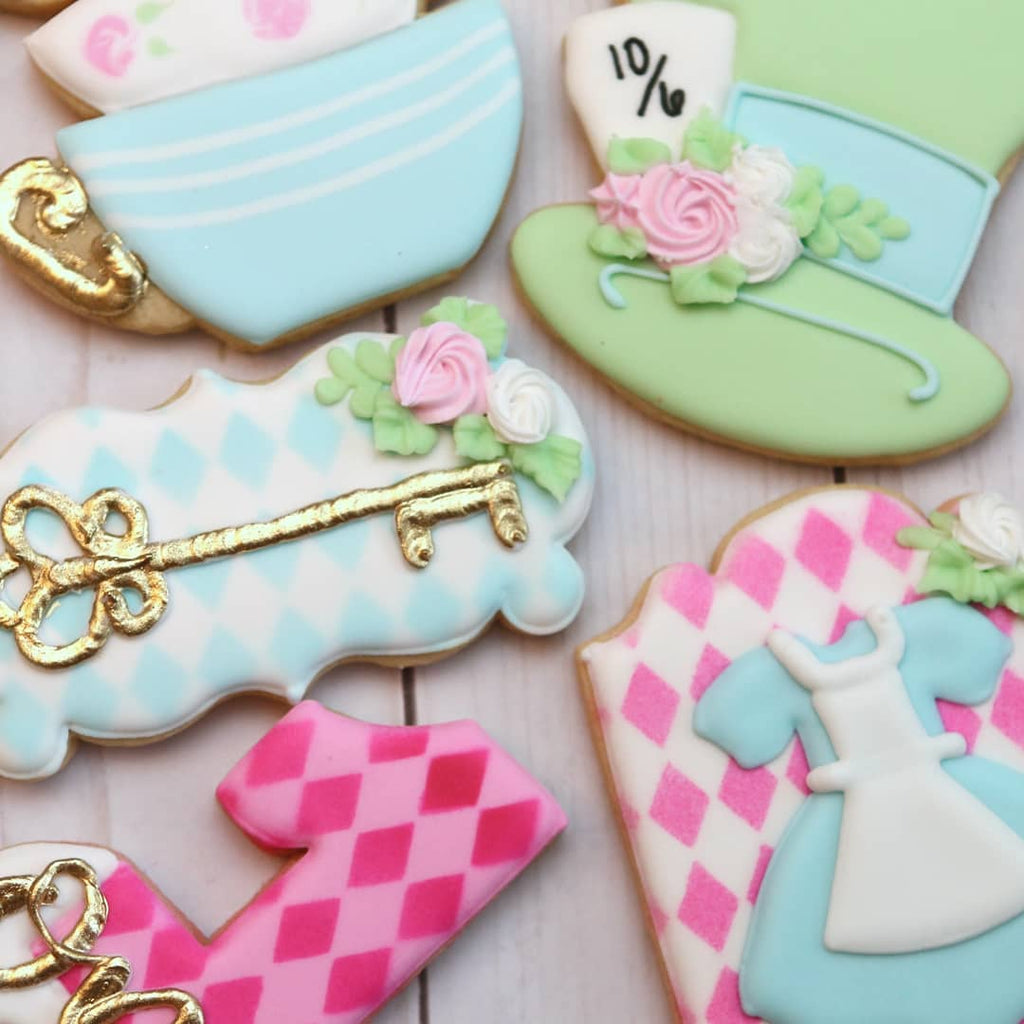 Alice In Onederland First Birthday Party Iced Sugar Cookies Alice In Wonderland Mad Hatter Custom Cookies Created by @SweetMazies #sugarcookies #cookies #baking #aliceinwonderlandcookies #theicedsugarcookie