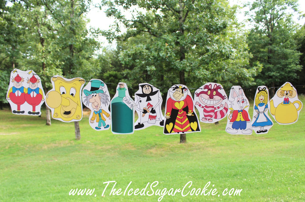 Free Alice In Wonderland Hanging Flag Banner Printable Template Pattern Garland Printables Birthday Party White Rabbit Tweedle Dee Dum Doorknob Mad Hatter Teapot Mouse Queen of Hearts Drink Me Playing Card Guard Cheshire Cat by The Iced Sugar Cookie