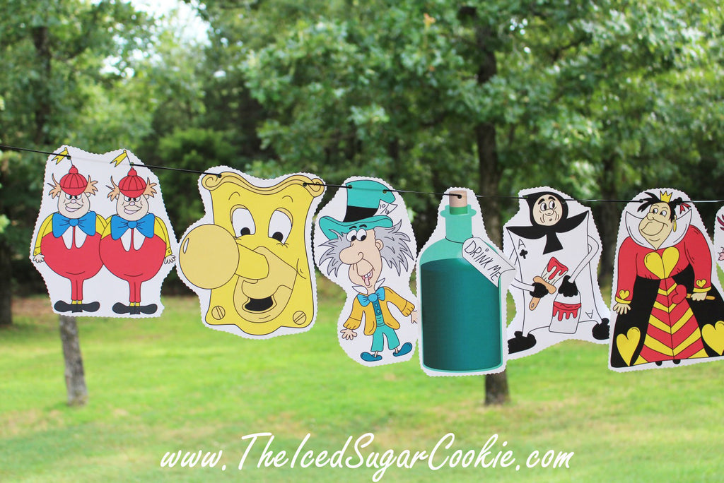 Free Alice In Wonderland Flag Bunting Banner Garland Template Pattern Cutout Printable Printables Birthday Party White Rabbit Tweedle Dee Dum Doorknob Mad Hatter Teapot Mouse Queen of Hearts Drink Me Playing Card Guard Cheshire Cat by The Iced Sugar Cookie