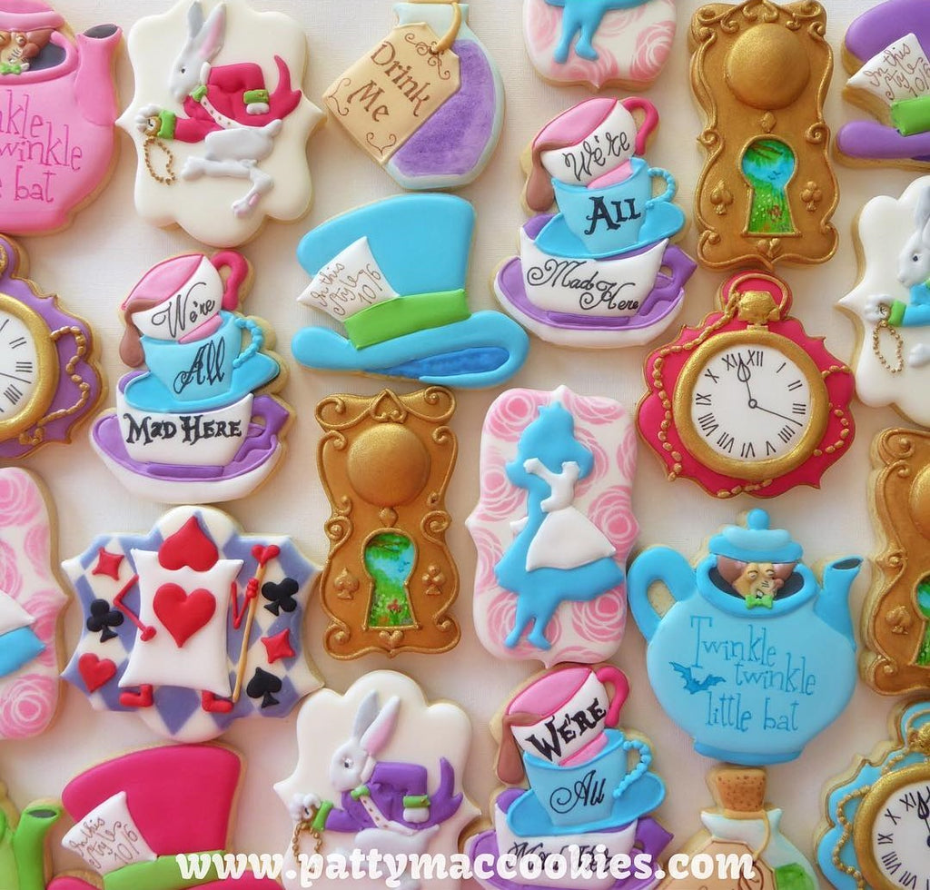 Alice In ONE-derland Iced Sugar Cookies featured on TheIcedSugarCookie.com created by @pattymaccookies #cookies #aliceinwonderlandcookies #aliceinwonderland #aliceinwonderlandsugarcookies #sugarcookies #partyideas #baking