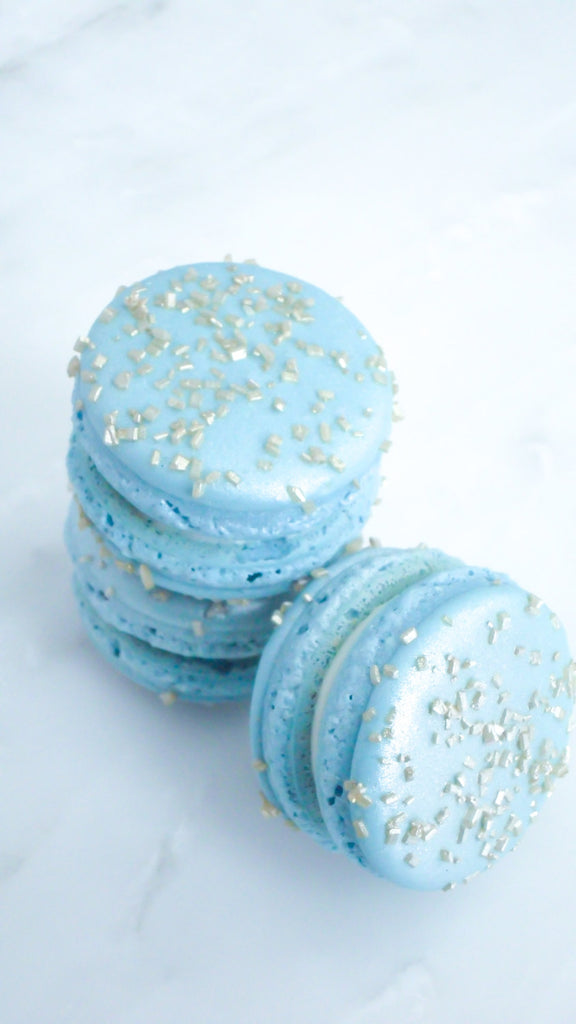 Elegant Baby Blue French Macarons With Gold Glitter Sugar Crystals & Madagascar Vanilla Ganache TheIcedSugarCookie.com Splendid Sweet Shoppe